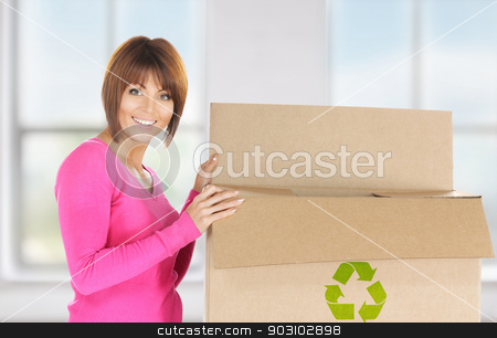 attractive businesswoman with recyclable box stock photo, picture of attractive businesswoman with recyclable box by Syda Productions