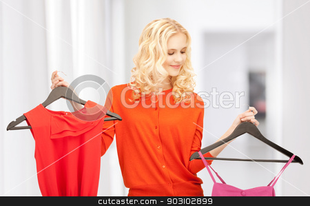lovely woman with clothes stock photo, bright picture of lovely woman with clothes by Syda Productions