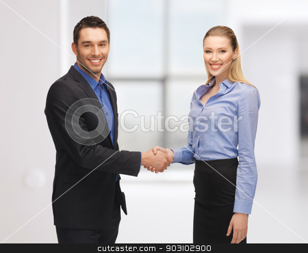 man and woman shaking their hands stock photo, bright picture of man and woman shaking their hands by Syda Productions
