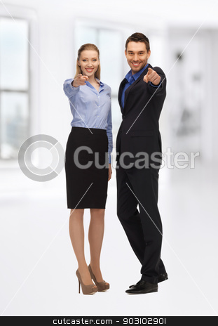 man and woman pointing their fingers stock photo, bright picture of man and woman pointing their fingers by Syda Productions
