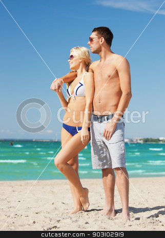 happy couple in sunglasses on the beach stock photo, picture of happy couple in sunglasses on the beach. by Syda Productions