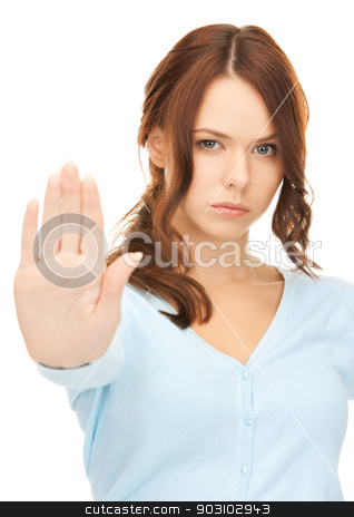 woman making stop gesture stock photo, bright picture of young woman making stop gesture.. by Syda Productions