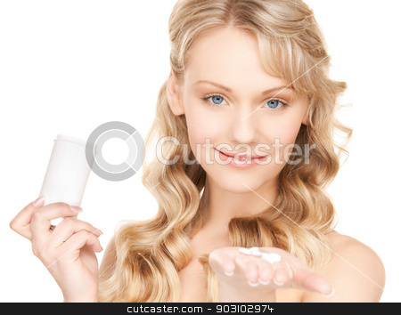 woman with pills stock photo, bright picture of beautiful woman with pills by Syda Productions