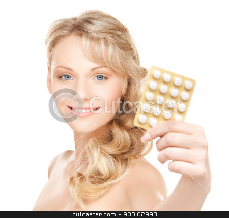 woman with pills stock photo, picture of young beautiful woman with pills . by Syda Productions