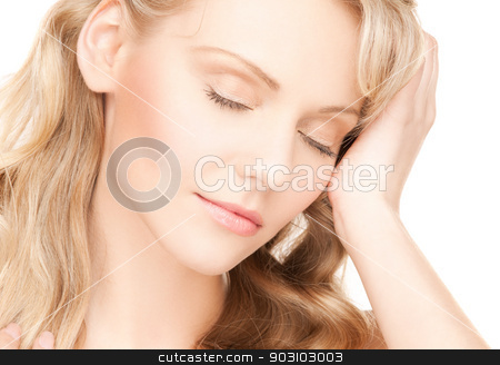 worried woman with long hair stock photo, face and hands of worried woman with long hair by Syda Productions