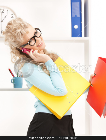 woman with folders and cell phone stock photo, picture of woman with folders and cell phone by Syda Productions