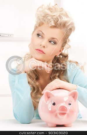 lovely woman with piggy bank stock photo, bright picture of lovely woman with piggy bank by Syda Productions