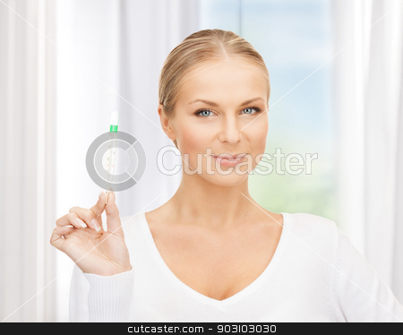 female doctor with thermometer stock photo, picture of attractive female doctor with thermometer by Syda Productions