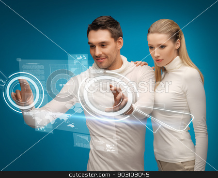 man and woman working with virtual screens stock photo, picture of man and woman working with virtual screens by Syda Productions