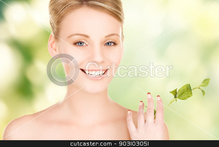 woman with sprout stock photo, picture of woman with sprout by Syda Productions