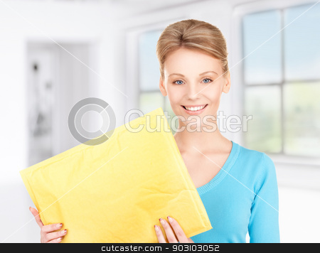 businesswoman with parcel stock photo, picture of businesswoman with parcel by Syda Productions
