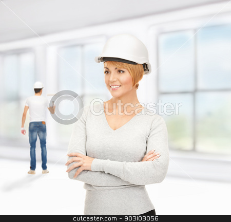 contractor and builder stock photo, bright picture of female contractor and builder by Syda Productions