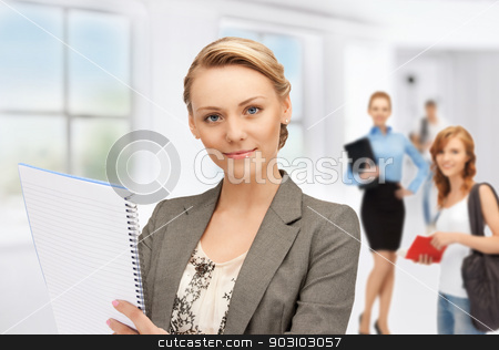 teacher and students stock photo, picture of teacher with notebook and students by Syda Productions
