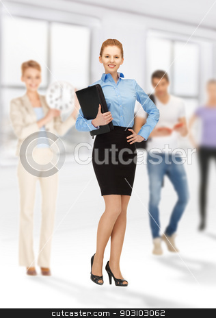 teacher and students stock photo, bright picture of smiling teacher and students by Syda Productions