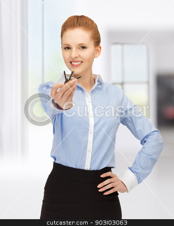 happy woman with keys stock photo, bright picture of happy woman with keys by Syda Productions
