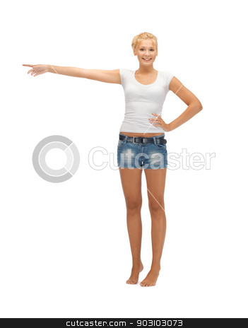 teenage girl poining her finger stock photo, happy teenage girl in blank white t-shirt poining her finger by Syda Productions