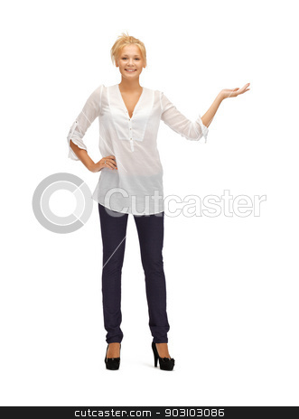 beautiful teenage girl in casual clothes stock photo, picture of teenage girl with something on palm by Syda Productions