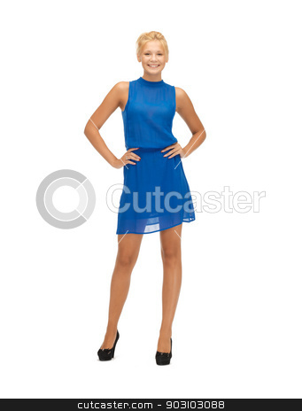 lovely teenage girl in blue dress stock photo, picture of lovely teenage girl in blue dress by Syda Productions