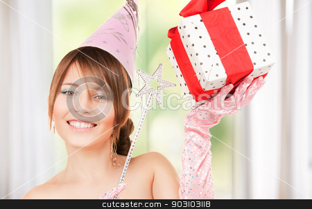 teenage party girl with magic wand and gift box stock photo, happy teenage party girl with magic wand and gift box by Syda Productions