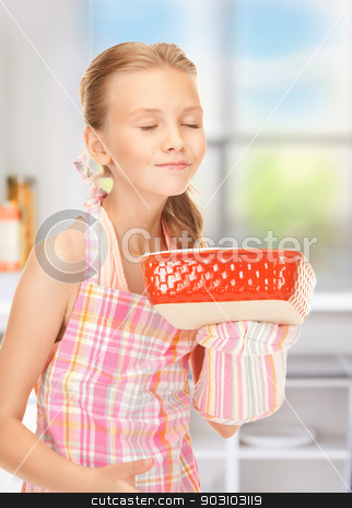 little housewife stock photo, bright picture of cooking girl in the kitchen by Syda Productions