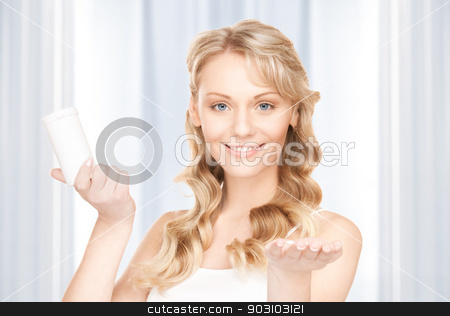young woman with pills stock photo, picture of young woman with pills by Syda Productions