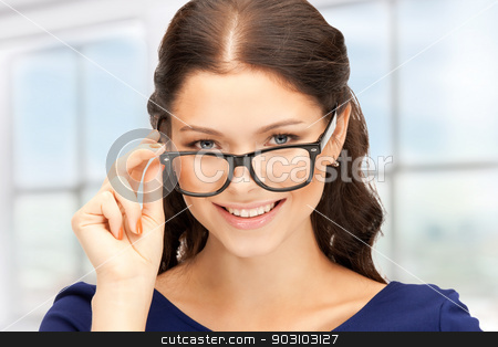 lovely woman in spectacles stock photo, closeup picture of lovely woman in spectacles by Syda Productions