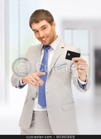 businessman with credit card stock photo, bright picture of happy businessman with credit card by Syda Productions