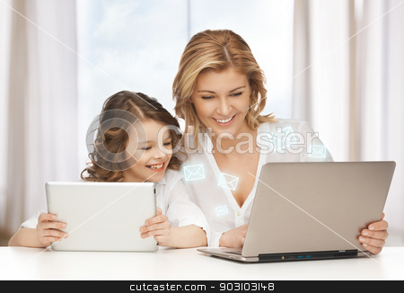 mother and daughter stock photo, mother and daughter with laptop and tablet pc by Syda Productions