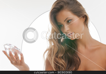 beautiful woman with diamond stock photo, face and hands of beautiful woman with diamond by Syda Productions