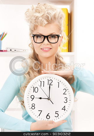 attractive businesswoman with clock stock photo, bright picture of attractive businesswoman with clock by Syda Productions