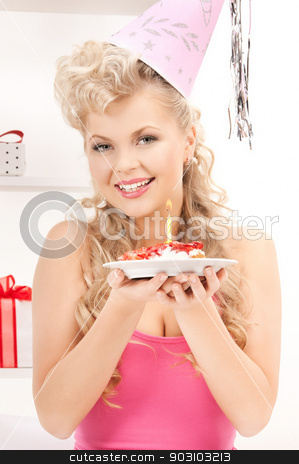 woman with birthday cake stock photo, bright picture of woman with birthday cake by Syda Productions