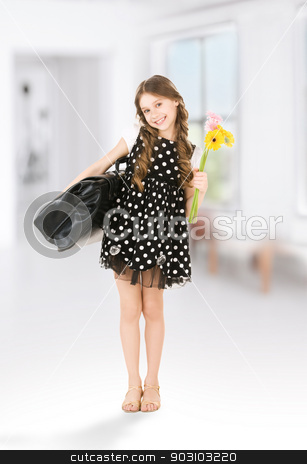 student stock photo, bright picture of elementary school student girl by Syda Productions