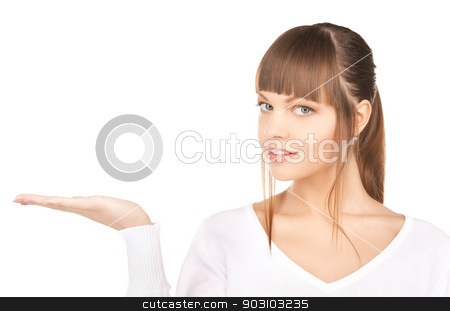 something on the palm stock photo, smiling woman showing something on the palm of her hand by Syda Productions