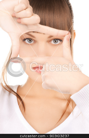 woman creating a frame with fingers stock photo, picture of lovely woman creating a frame with fingers by Syda Productions