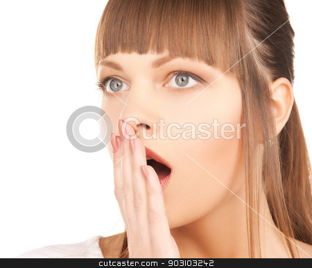 woman with hand over mouth stock photo, bright closeup picture of woman with hand over mouth. by Syda Productions