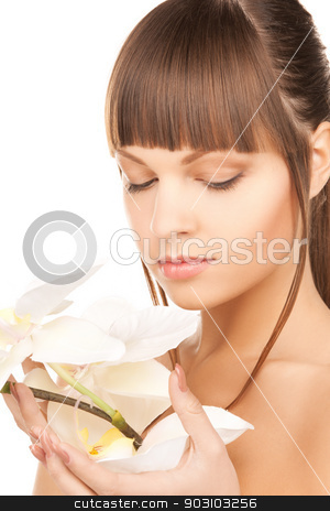 lovely woman with orchid flower stock photo, bright picture of lovely woman with orchid flower. by Syda Productions