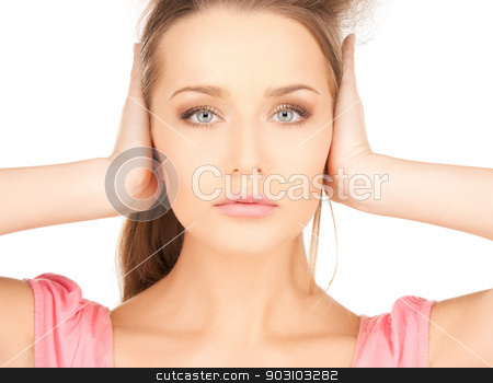 beautiful woman in casual clothes stock photo, bright picture of beautiful woman with hands on ears by Syda Productions