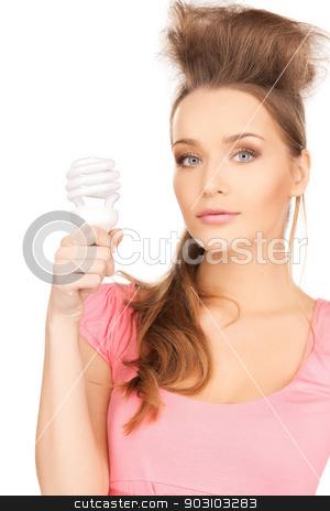 woman with energy saving bulb stock photo, picture of beautiful woman with energy saving bulb by Syda Productions