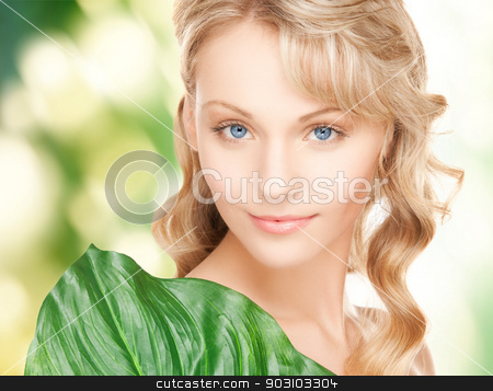 woman with green leaf stock photo, picture of happy woman with green leaf by Syda Productions