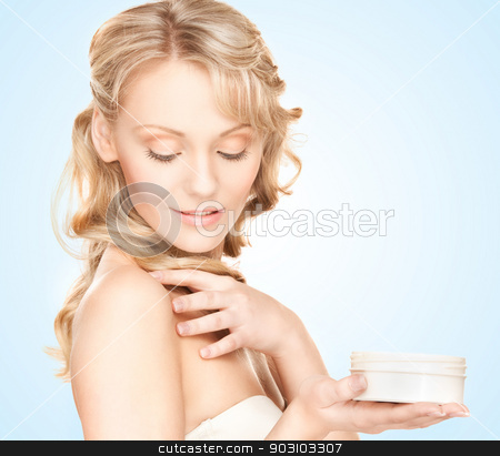 beautiful woman with moisturizing creme stock photo, picture of beautiful woman with moisturizing creme by Syda Productions