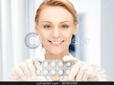 attractive female doctor with pills stock photo, picture of attractive female doctor with pills by Syda Productions