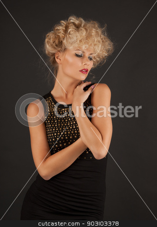woman in black dress stock photo, picture of calm and serious woman in black dress by Syda Productions