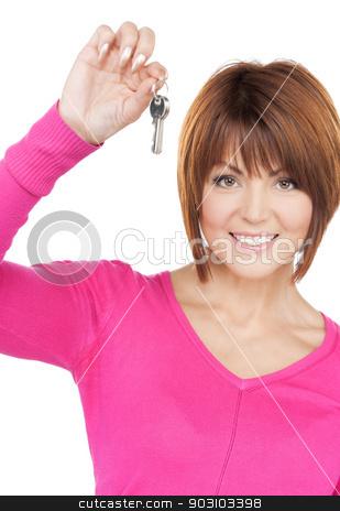 happy woman with keys stock photo, bright picture of happy woman with keys by Syda Productions