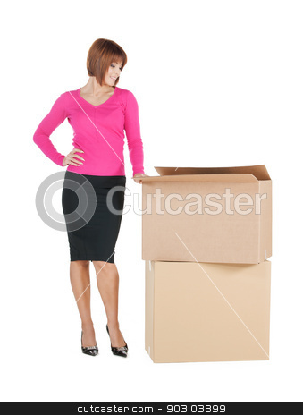 businesswoman with big boxes stock photo, picture of attractive businesswoman with big boxes.. by Syda Productions