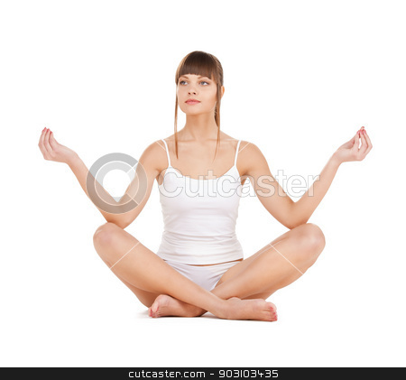 woman practicing yoga stock photo, sporty woman in cotton underwear practicing yoga lotus pose by Syda Productions