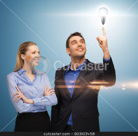 man and woman with light bulb stock photo, bright picture of man and woman with light bulb by Syda Productions