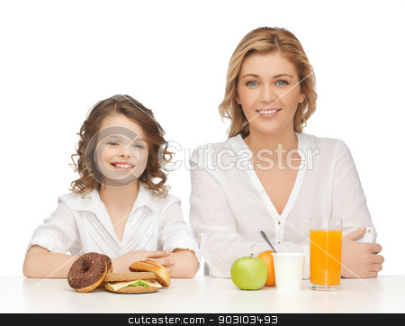 mother and daughter stock photo, mother and daughter with healthy and unhealthy food by Syda Productions