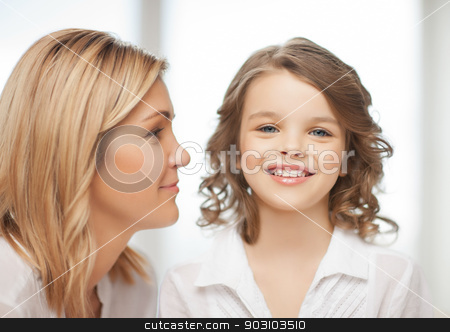mother and daughter stock photo, bright closeup picture of mother and daughter by Syda Productions