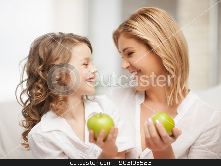 mother and daughter stock photo, picture of mother and daughter with green apples by Syda Productions