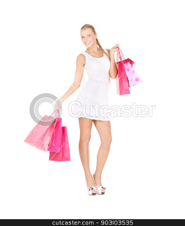 shopper stock photo, picture of lovely woman with shopping bags. by Syda Productions